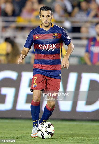 Pedro Rodriguez of FC Barcelona drives the ball during the first half of friendly soccer match against Los Angeles Galaxy in the International...