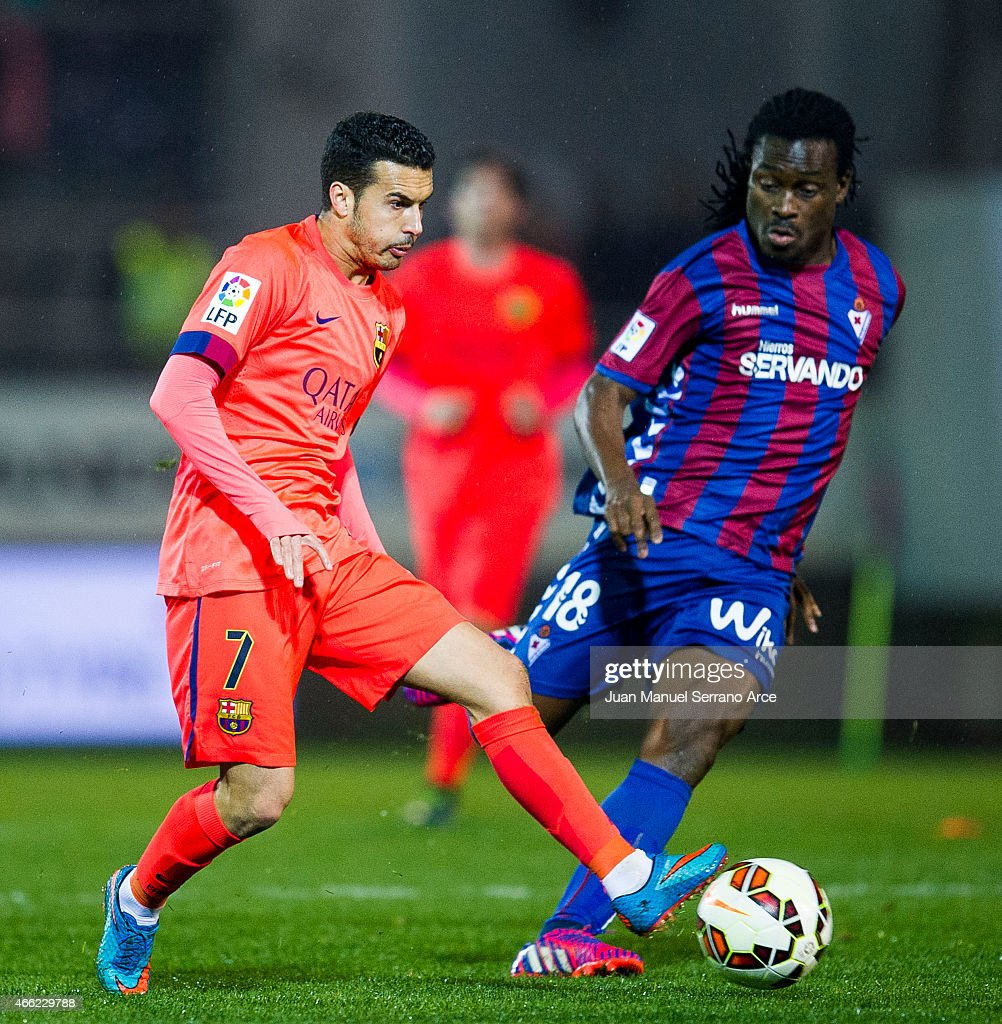 Pedro Rodriguez of FC Barcelona duels for the ball with <a gi-track='captionPersonalityLinkClicked' href=/galleries/search?phrase=Derek+Boateng&family=editorial&specificpeople=535783 ng-click='$event.stopPropagation()'>Derek Boateng</a> of SD Eibar during the La Liga match between SD Eibar and FC Barcelona at Ipurua Municipal Stadium on March 14, 2015 in Eibar, Spain.
