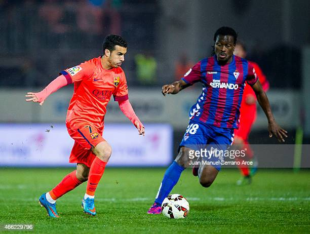 Pedro Rodriguez of FC Barcelona duels for the ball with Derek Boateng of SD Eibar during the La Liga match between SD Eibar and FC Barcelona at...