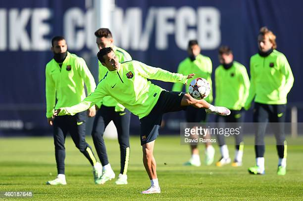 Pedro Rodriguez of FC Barcelona kicks the ball during a training session ahead of their UEFA Champions League Group F match against Paris...