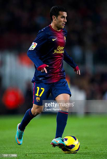 Pedro Rodriguez of FC Barcelona runs with the ball during the La Liga match between FC Barcelona and RCD Espanyol at Camp Nou on January 6 2013 in...