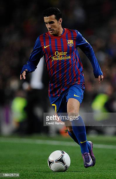 Pedro Rodriguez of FC Barcelona runs with the ball during the round of last 16 Copa del Rey 1st leg match between FC Barcelona and CZ Osasuna at Camp...