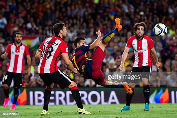 Pedro Rodriguez of FC Barcelona tries an overhead kick between Carlos Gurpegi and Benat Etxebarria of Athletic Club during the Spanish Super Cup...