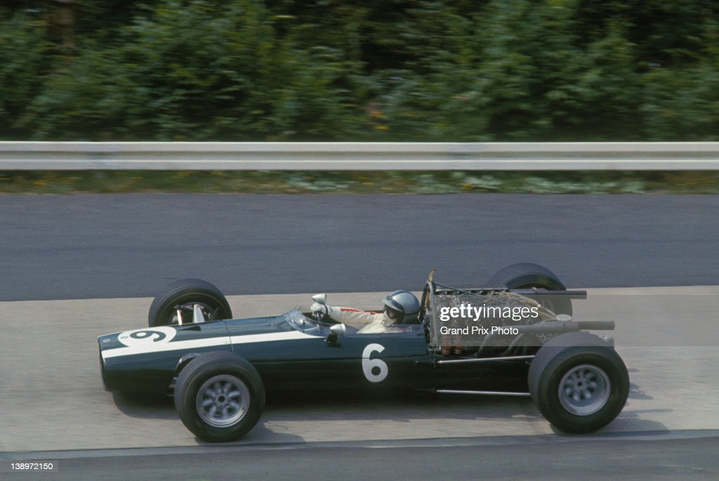 Pedro Rodriguez of Mexico drives the #6 Cooper Car Company Cooper T81 Maserati V12 through the Karussell during the German Grand Prix on 6th August 1967 at the Nurburgring near Nurburg, Germany.