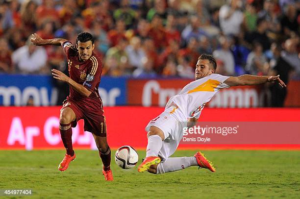Pedro Rodriguez of Spain battles for the ball against Muhamed Demiri of FYR of Macedonia during the UEFA EURO 2016 Group C Qualifier between Spain...