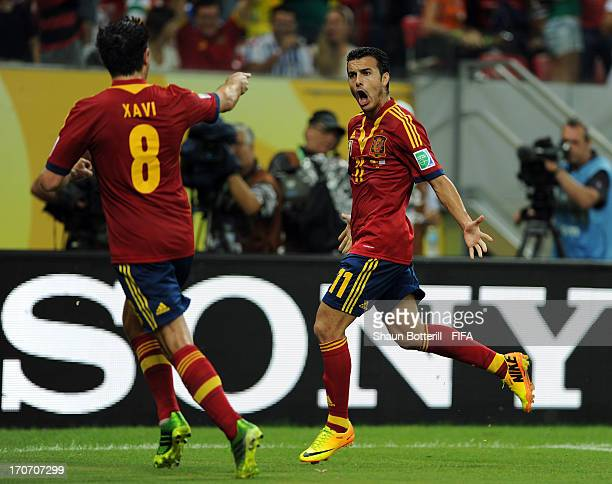 Pedro Rodriguez of Spain celebrates as he scores their first goal with Xavi Hernandez during the FIFA Confederations Cup Brazil 2013 Group B match...