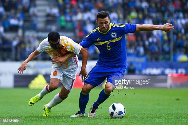 Pedro Rodriguez of Spain competes for the ball with Sead Kolasinac of Bosnia during an international friendly match between Spain and Bosnia at the...