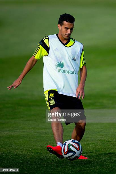 Pedro Rodriguez of Spain controls the ball during a training sesion at Ciudad del Futbol on May 26 2014 in Las Rozas de Madrid Spain