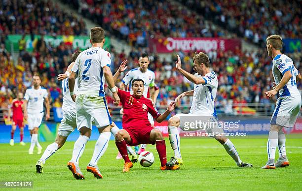 Pedro Rodriguez of Spain duels for the ball with Norbert Gyomber of Slovakia during the Spain v Slovakia EURO 2016 Qualifier at Carlos Tartiere on...