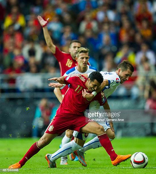 Pedro Rodriguez of Spain duels for the ball with Peter Pekarik of Slovakia during the Spain v Slovakia EURO 2016 Qualifier at Carlos Tartiere on...