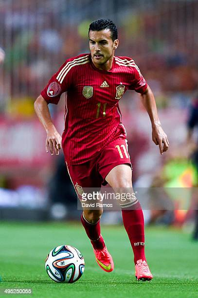 Pedro Rodriguez of Spain runs with the ball during an international friendly match between Spain and Bolivia at Estadio Ramon Sanchez Pizjuan on May...