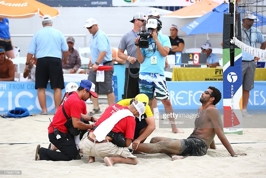 Pedro Salgado of Brazil gets a bandage put on a hurt ankle during a men's international semi final match at the ASICS World Series Cup - Day 2 on July 28, 2013 in Long Beach, California.