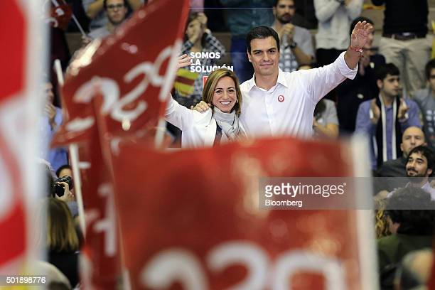 Pedro Sanchez leader of Partidos Socialista Obrero Espanol right and Carmen Chacon leader for Barcelona of Catalan Socialist Workers' Party wave to...