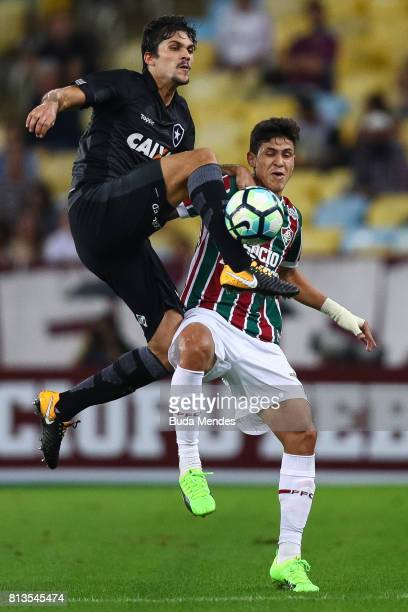 Pedro Santos of Fluminense struggles for the ball with Igor Rabello of Botafogo during a match between Fluminense and Botafogo as part of Brasileirao...