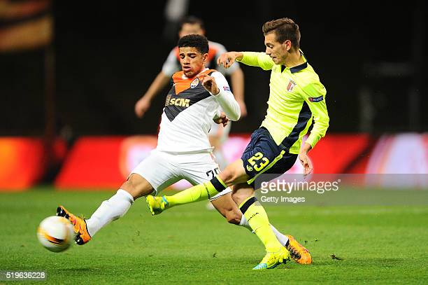 Pedro Santos of SC Braga challenges Taison of Shakhtar Donetsk during the UEFA Europa League Quarter Final first leg match between SC Braga and...