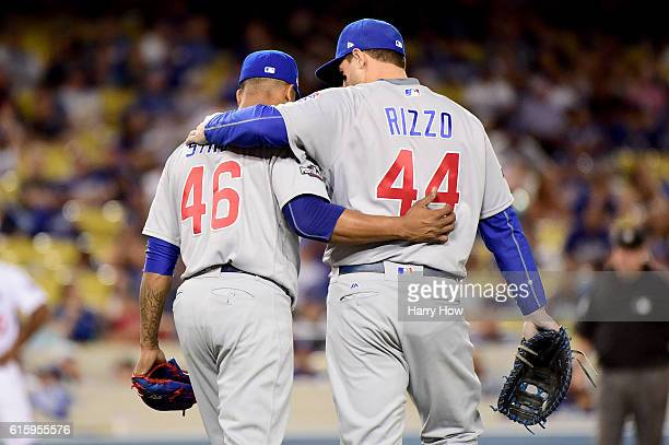 Pedro Strop and Anthony Rizzo of the Chicago Cubs embrace in the eighth inning while taking on the Los Angeles Dodgers in game five of the National...
