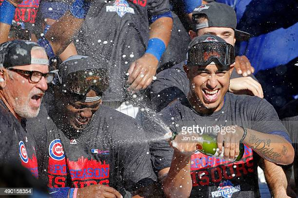 Pedro Strop of the Chicago Cubs celebrates with manager Joe Maddon after clinching their Wildcard position after their game against the Pittsburgh...