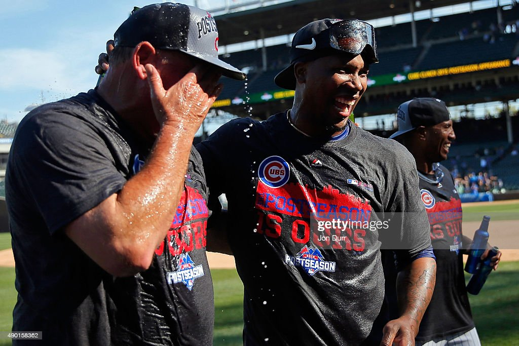 Pedro Strop #46 of the Chicago Cubs (R) celebrates with pitching coach Chris Bosio #25 after clinching their Wildcard position after their game against the Pittsburgh Pirates at Wrigley Field on September 26, 2015 in Chicago, Illinois.