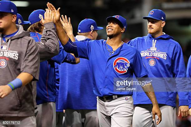 Pedro Strop of the Chicago Cubs high fives teammates after defeating the Cleveland Indians 93 to win Game Six of the 2016 World Series at Progressive...
