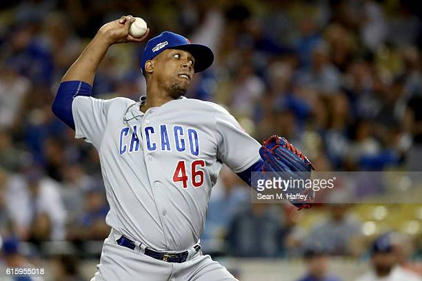 Pedro Strop of the Chicago Cubs pitches against the Los Angeles Dodgers in game five of the National League Division Series at Dodger Stadium on...