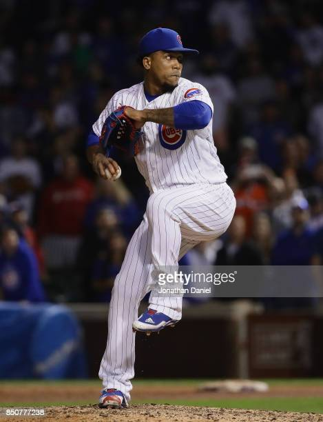Pedro Strop of the Chicago Cubs pitches in the 9th inning against the New York Mets at Wrigley Field on September 12 2017 in Chicago Illinois The...