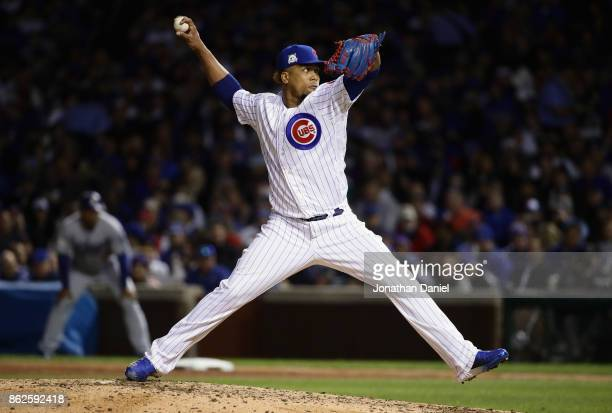 Pedro Strop of the Chicago Cubs pitches in the seventh inning against the Los Angeles Dodgers during game three of the National League Championship...