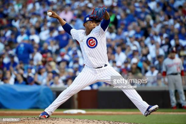 Pedro Strop of the Chicago Cubs pitches in the sixth inning against the Washington Nationals during game three of the National League Division Series...