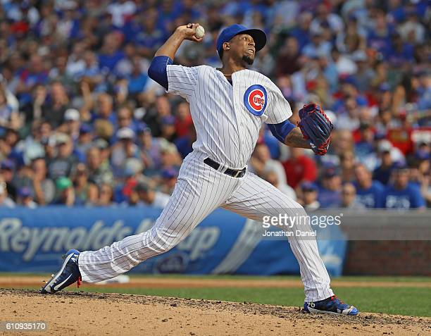 Pedro Strop of the Chicago Cubs pitching in his first game since coming off the disabled list delivers the ball in the 8th inning against the St...
