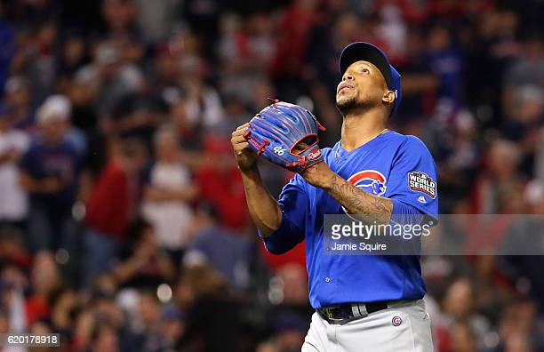 Pedro Strop of the Chicago Cubs reacts as he walks back to the dugout after being relieved during the ninth inning against the Cleveland Indians in...