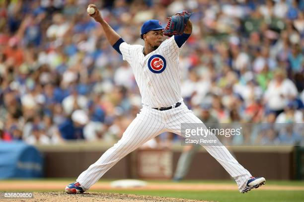 Pedro Strop of the Chicago Cubs throws a pitch during a game against the Toronto Blue Jays at Wrigley Field on August 20 2017 in Chicago Illinois The...