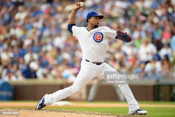 Pedro Strop of the Chicago Cubs throws a pitch during the eighth inning of a game against the Toronto Blue Jays at Wrigley Field on August 20 2017 in...