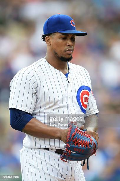 Pedro Strop of the Chicago Cubs walks off the field during a game against the Toronto Blue Jays at Wrigley Field on August 20 2017 in Chicago...