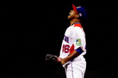 Pedro Strop of the Dominican Republic reacts after retiring the side in the seventh against Puerto Rico during the Championship Round of the 2013...