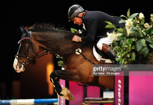 Pedro VI ridden by Great Britain's Geoff Billington competes in the second round of the British Open Show Jumping Championships at the NEC Birmingham