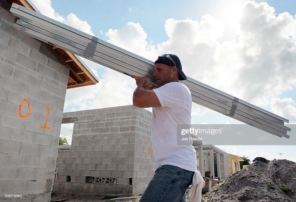 Pedro Victorero carries material as he helps build a Habitat for Humanity home on August 3, 2010 in Fort Lauderdale, Florida. In July, Habitat for Humanity was named the eighth largest homebuilder in the United States by Builder's Magazine, the first time the nonprofit has been among the top 10 biggest builders in the United States.