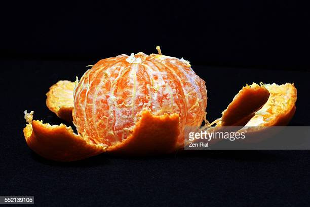 Peeled Orange On Black Background