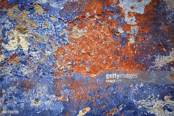 Peeling paint on old wall. Background texture