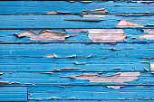 Textured background - bright blue peeling paint on old weathered wood