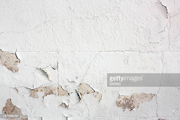 Peeling white-painted wall detail