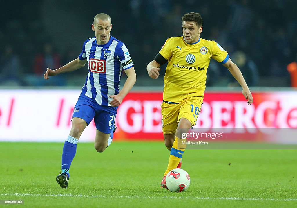Peer Kluge (L) of Berlin battles for the ball with Mirko Boland (R) of Braunschweig during the Second Bundesliga match between Hertha BSC Berlin and Eintracht Braunschweig at Olympic stadium on April 8, 2013 in Berlin, Germany.