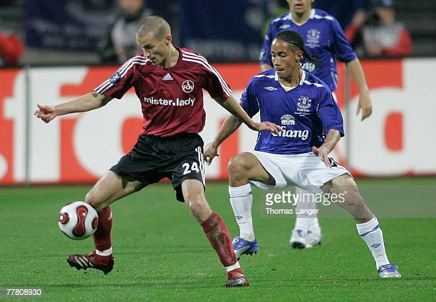 Peer Kluge of Nuremberg and Steven Pienaar of Everton battle for the ball during the UEFA Cup Group A match between 1 FC Nuremberg and FC Everton at...