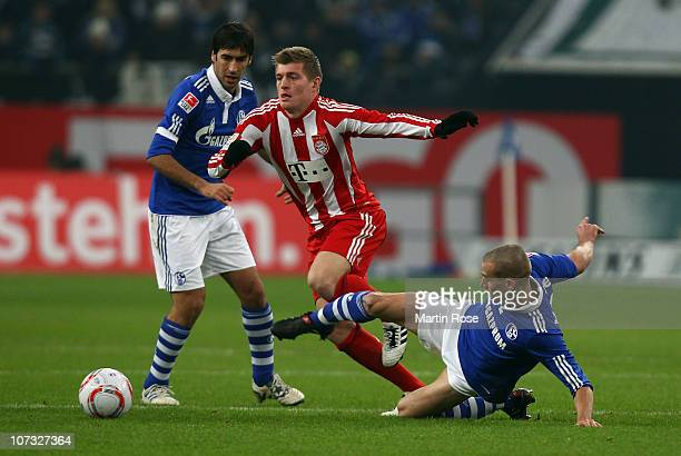 Peer Kluge of Schalke and Toni Kroos of Bayern Muenchen battle for the ball during the Bundesliga match between FC Schalke 04 and Bayern Muenchen at...
