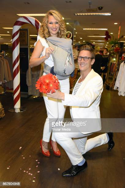 Peer Kusmagk his girlfriend Janni Hoenscheid and their son EmilOcean Kusmagk attend the TK Maxx 10th anniversary celebration on October 18 2017 in...