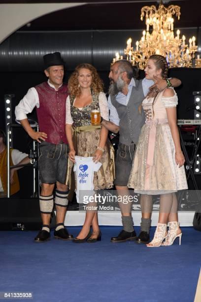 Peer Kusmagk his girlfriend Janni Hoenscheid Senay Gueler and Joelina Drews during the Angermaier TrachtenNacht at Hofbraeuhaus on August 31 2017 in...