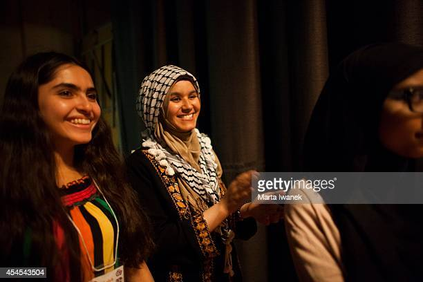 Peer Leaders Laleh Azadani from Afghanistan and Hanan AlSamaneh from Palestine cheer students during the show put on by participants of the NOW...