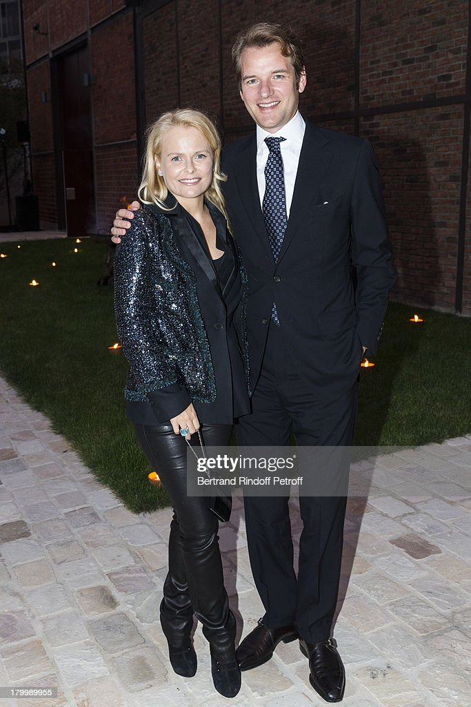 Peer M. Schatz (R) and his wife Nadine Grandjean-Schatz attend the Georg Baselitz exhibition preview and dinner at Thaddeus Ropac Gallery on September 7, 2013 in Pantin, east of Paris, France. The exhibition opens on September 8.