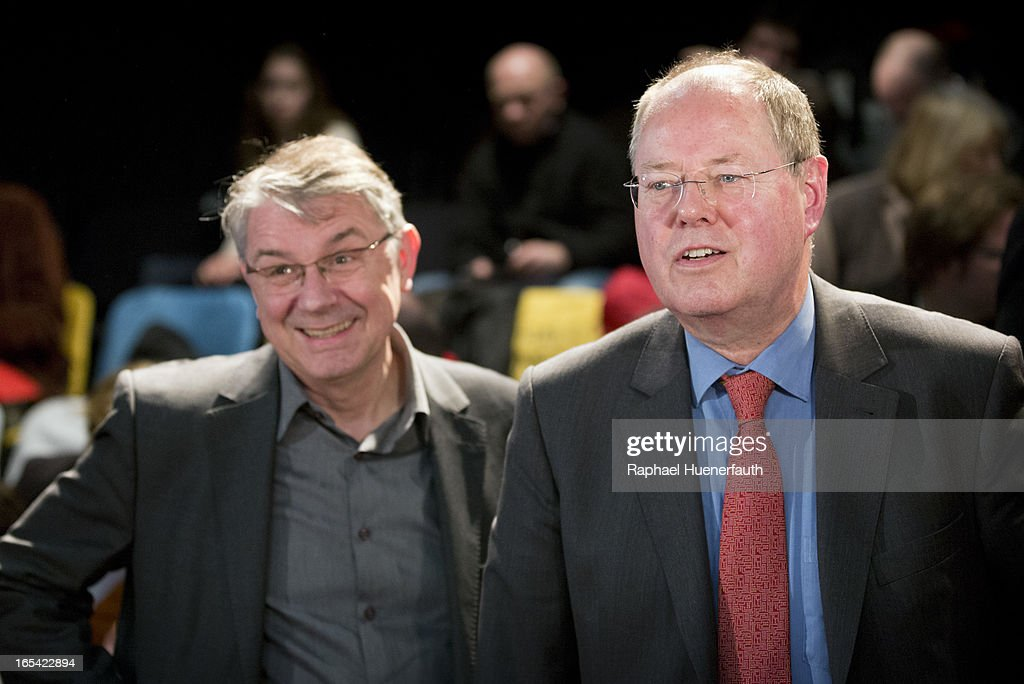Peer Steinbrueck (R), candidate for chancellor of the German Social Democrats (SPD), and director of Deutsches Theater Ulrich Khuon attend a rehearsal of the theater play '2035 oder Mit 40 eroeffne ich ein Hotel auf dem Mond' at Deutsches Theater on April 03, 2013 in Berlin, Germany. Steinbrueck will challenge German Chancellor Angela Merkel in federal elections scheduled for September, though so far he is trailing significantly in polls.
