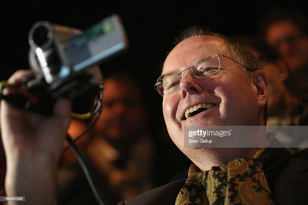 "Peer Steinbrueck, candidate for chancellor of the German Social Democrats (SPD), films with a video camera while attending a rehearsal of ""Junges Deutsches Theater"" (Young German Theater) at the Deutsches Theater during a tour of enterprises in Berlin on April 3, 2013 in Berlin, Germany. Steinbrueck will challenge German Chancellor Angela Merkel in federal elections scheduled for September, though so far he is trailing significantly in polls."