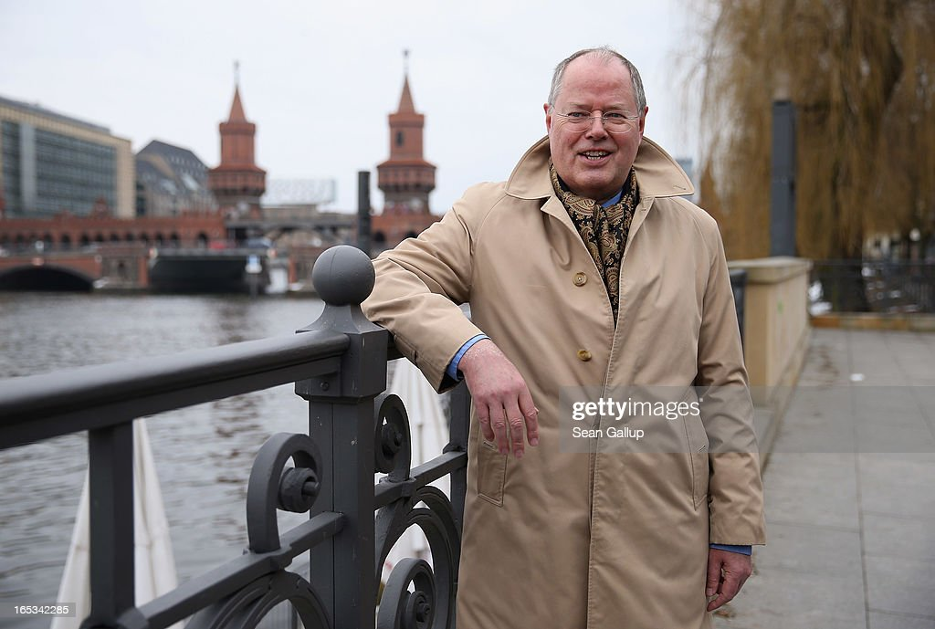 Peer Steinbrueck, candidate for chancellor of the German Social Democrats (SPD), pauses to pose for a brief photo after walking across Oberbaumbruecke bridge during a tour of enterprises in Berlin on April 3, 2013 in Berlin, Germany. Steinbrueck will challenge German Chancellor Angela Merkel in federal elections scheduled for September, though so far he is trailing significantly in polls.