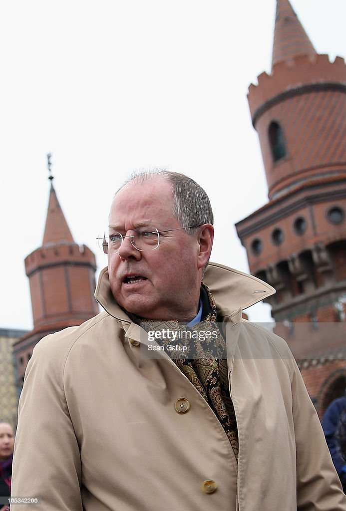 Peer Steinbrueck, candidate for chancellor of the German Social Democrats (SPD), walks across Oberbaumbruecke bridge during a tour of enterprises in Berlin on April 3, 2013 in Berlin, Germany. Steinbrueck will challenge German Chancellor Angela Merkel in federal elections scheduled for September, though so far he is trailing significantly in polls.